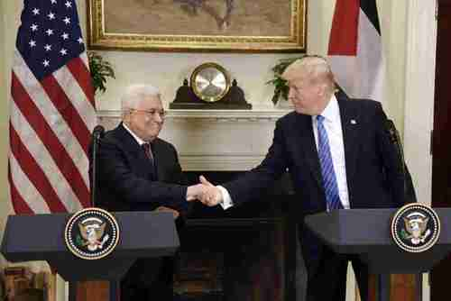 Mahmoud Abbas and Donald Trump shake hands at the White House on Wednesday (Getty)