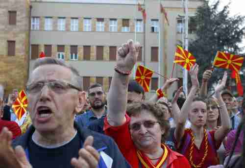 Protesters in front of parliament in Skopje, Macedonia, on Tuesday (Reuters)