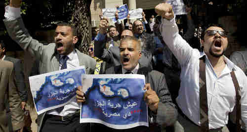 Dozens of Egyptian lawyers shout slogans during a protest in front of the Lawyers' Syndicate in Cairo against the agreement to hand over Tiran and Sanafir to Saudi Arabia. (AP)