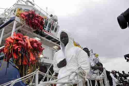 Migrants from Africa arrive in Italy on a rescue ship