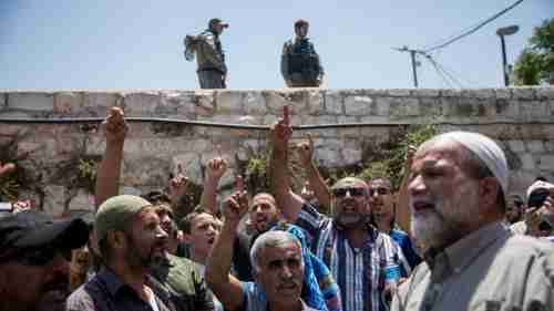 Muslim worshippers chant slogans outside the al-Aqsa mosque (Times of Israel)