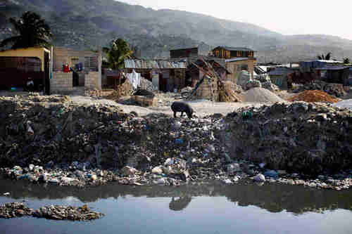 People dump trash and raw sewage into canals that run through Port-au-Prince, Haiti. When it rains, the canals overflow and flood poor neighborhoods. (NPR)