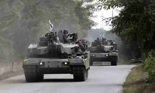 South Korean tanks take part in exercises in Paju, near the border with North Korea, on Monday. Donald Trump tweeted on Tuesday, 'I am allowing Japan & South Korea to buy a substantially increased amount of highly sophisticated military equipment from the United States.' (AP)