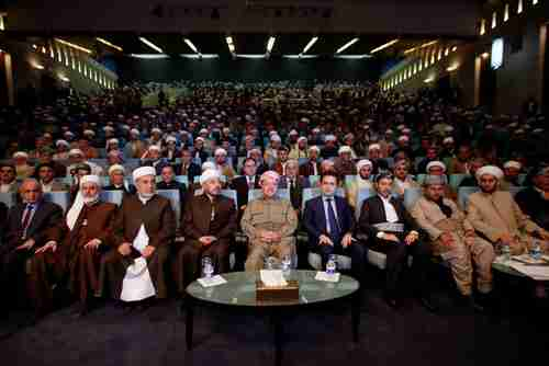 Iraqi Kurdish leader Massoud Barzani (C) sits during his meeting with clerics and elders in Erbil last month (Reuters)