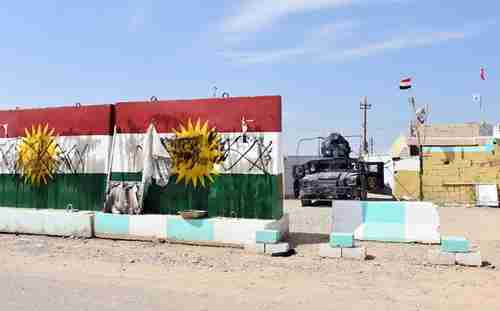 Defaced Kurdistan flags at a former Peshmerga position now held by Iraqi forces on Friday (AFP)