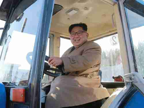The gargantuan Kim Jong-un inspects a tractor factory last week