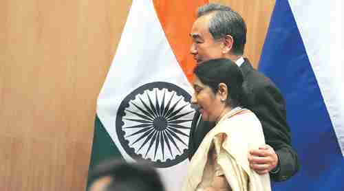 After their meeting, China's foreign minister Wang Yi used his arm to comfort India's foreign minister, External Affairs Minister Sushma Swaraj (Indian Express)