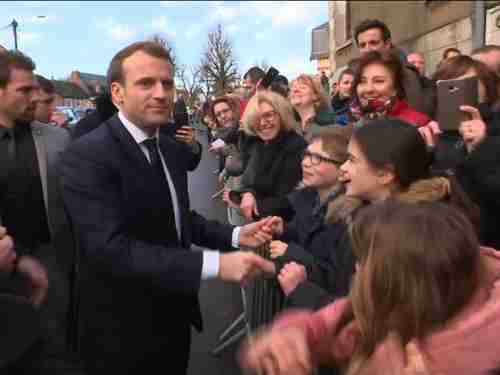 Emmanuel Macro was warmly received by residents of Calais on Tuesday (Sky News)
