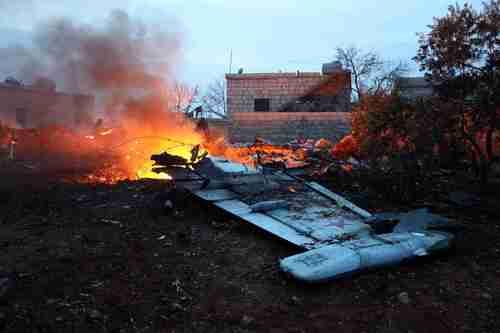 Russian warplane shot down in Idlib province last week by al-Qaeda linked Hayat Tahrir al-Sham (HTS), using a portable surface-to-air missile. (AFP)