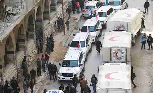 Trucks from humanitarian convoy in Eastern Ghouta on Monday (Reuters)