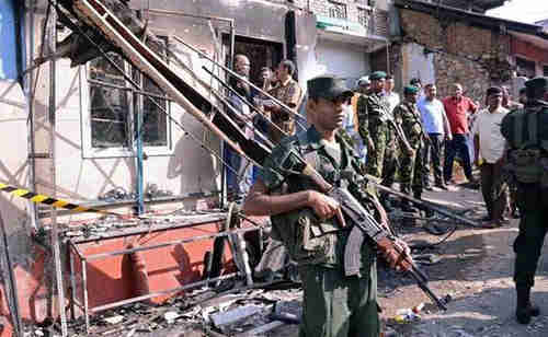 Sri Lanka government troops enforce curfew in Kandy district on Tuesday (Reuters)