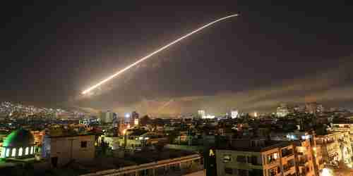 Early Saturday morning in Damascus, Syria, surface to air missiles light up the sky (AP)