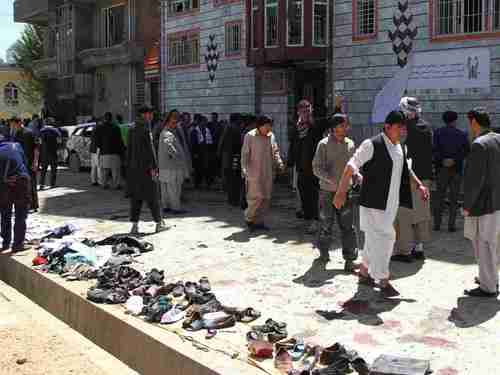Clothes and shoes are seen at the site of a suicide bomb attack in Kabul, Afghanistan, on Sunday. The items were placed in a row for the victims' families to claim afterwards. (Getty)