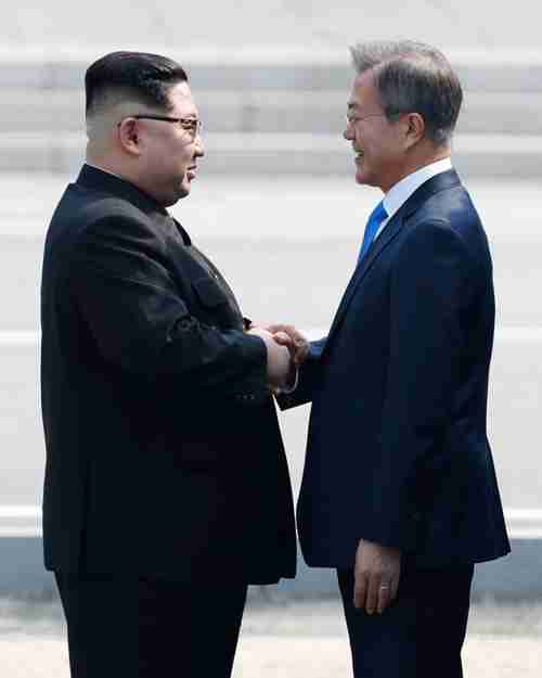 South Korean President Moon Jae-in and North Korean leader Kim Jong-un shake hands in front of Freedom House at Panmunjom, in April. (Korea Times)