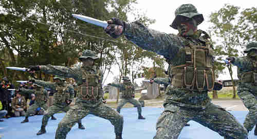 Taiwan's frogmen Marines perform close combat drills just a few kilometers from mainland China on the outlying island of Kinmen, Taiwan (AP)