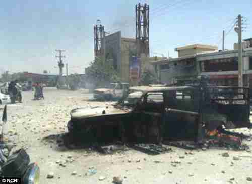 A picture of Kazerun on Friday shared on social media shows upturned and burnt out cars and wounded activists following violent scenes (NCRI)