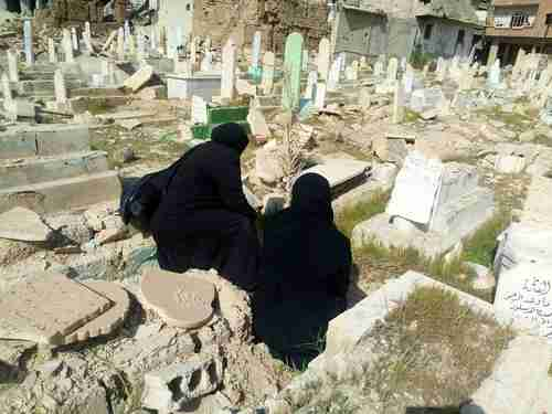 Two women bid farewell to their deceased families on March 24, before fleeing Ghouta for Idlib province (Syria Deeply)