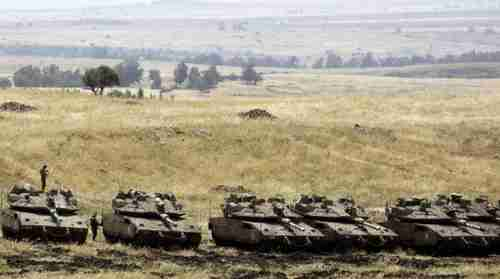 Israeli Merkava Mark IV tanks take positions near the Syrian border in the Golan Heights on May 10, 2018. (AFP)
