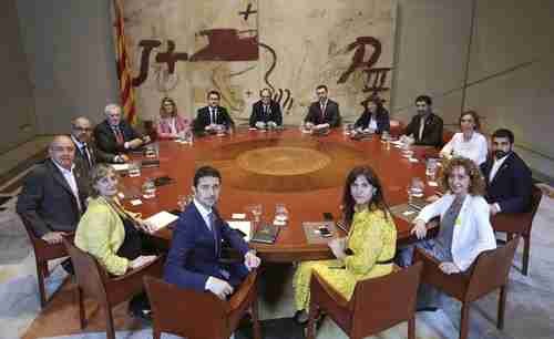 Catalonia's new government after swearing-in ceremony in Barcelona. (AP)