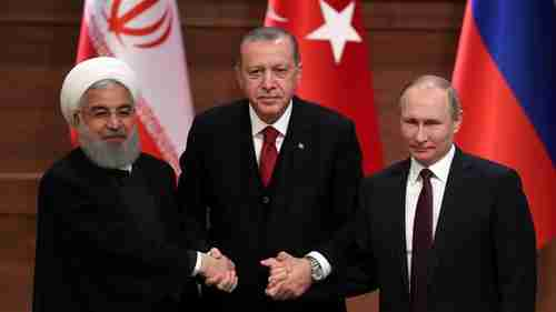Rouhani, Erdogan and Putin, the three amigos, hold hands prior to their meeting (Reuters)