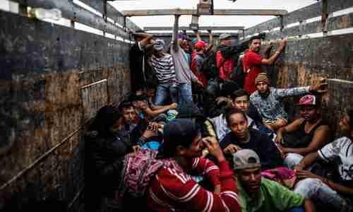 Venezuelan migrants travel aboard a truck in Tumbes, Peru, near the Ecuador border, on November 1. (AFP)