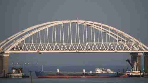Russia on Sunday blockaded the Sea of Azov with a tanker underneath the Kerch Strait bridge (AP)