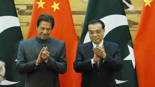 Pakistan's prime minister Imran Khan and China's Premier Li Keqiang in Beijing earlier this month, with Khan begging for aid. (Getty)
