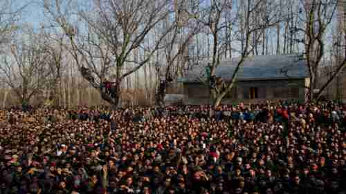 Kashmiris turn out for funeral of the civilians killed on Saturday (AP)