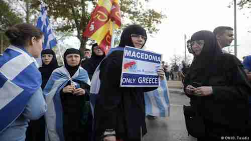 Greek Orthodox nuns holding Greek and Byzantine flags protest the Macedonia name deal
