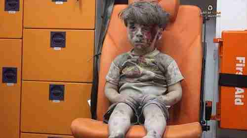 From August 2016: Five year old boy, Omran Daqneesh, sitting confused in an ambulance in Aleppo after being pulled from the rubble of one of Bashar al-Assad's airstrikes. To al-Assad, this boy and others like him are just cockroaches to be exterminated.