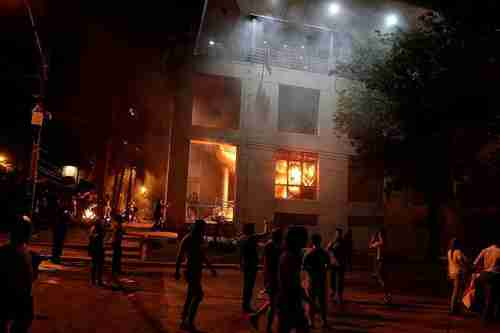 Protesters setting fire to Paraguay's National Congress building in Asunción on Friday night (Reuters)