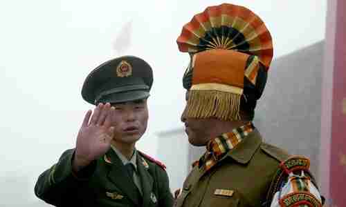 Chinese soldier confronts Indian soldier at border crossing (AFP)