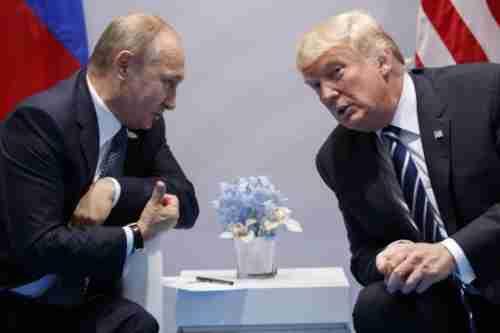 Vladimir Putin and Donald Trump meeting at the G20 summit in Hamburg on Friday (AP)