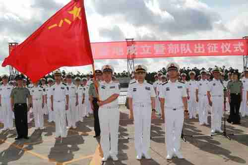 Chinese soldiers stand guard at a military port in Zhanjiang, Guangdong province, on Tuesday, as warships with soldiers depart for Djibouti (Reuters)