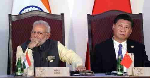India's prime minister Narendra Modi and China's president Xi Jinping at a meeting last year (AP)