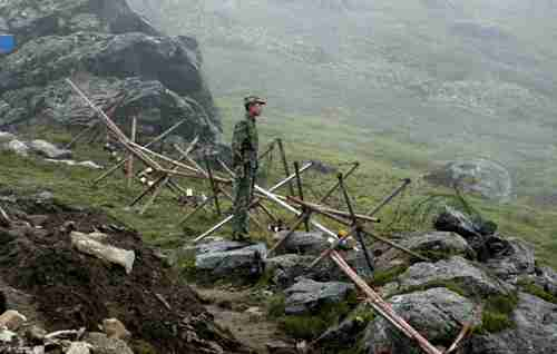 Chinese soldier stands guard on the Chinese side of the border crossing between India and China. (AFP)