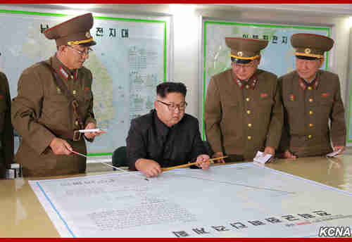 Kim Jong-un inspects the army's proposed plans for launching missiles towards Guam on Monday (KCNA)