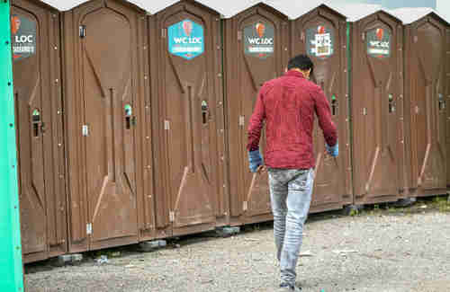 Ten court-ordered toilets for migrants have been set up near Calais (AFP)