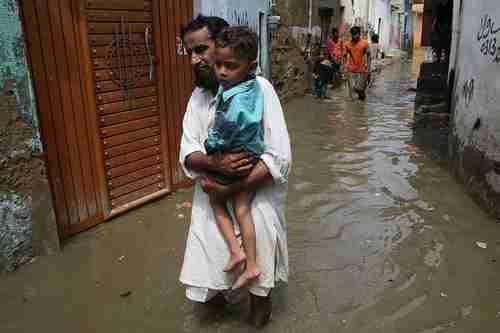A flooded street in Karachi on Friday (EPA)