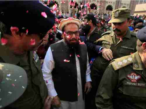 Hafiz Saeed, mastermind of the horrific 2008 26/11 Mumbai massacre, is released from jail and receives cheers and showers of rose petals (Reuters)