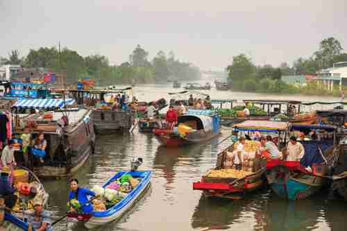 Floating marketplace in Mekong delta in Vietnam