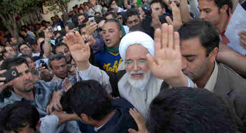 Mehdi Karroubi, opposition leader, surrounded by supporters on June 17, 2009 (Reuters)