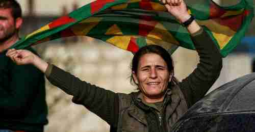 A Kurdish woman at an anti-Turkish rally near Afrin in norther Syria (AFP)