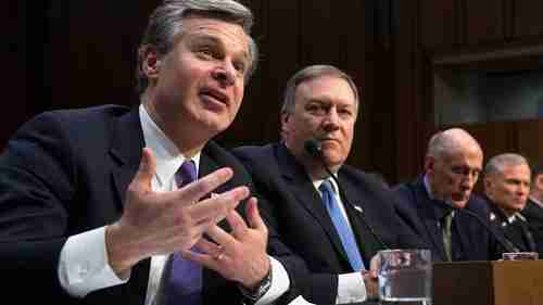 FBI Director Christopher Wray (L) and CIA Director Mike Pompeo (2nd L) testify to a Senate Intelligence Committee on Feb 13, advising Americans not to buy products from Chinese firms Huawei and ZTE (AFP)