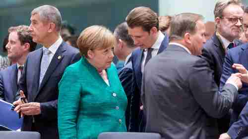 Angela Merkel speaks with other country leaders at EU Summit on Thursday and Friday (Getty)