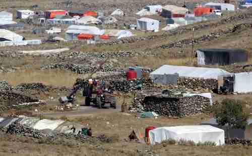 Displaced Syrians camp near Israeli-occupied Golan Heights on Saturday (AFP)