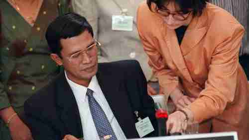 Prime minister Hun Sen signs Paris Peace Accords for Cambodia in 1991; last year he declared the accords to be dead 'ghosts' (AFP)