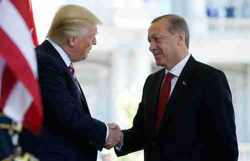 Presidents Trump and Erdogan shaking hands when they were still friendly (Reuters)