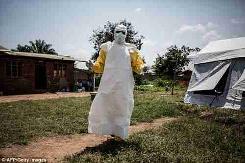 A health worker gets ready to perform Ebola medical checks in North Kivu (AFP)