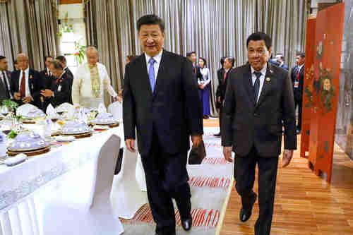 Xi Jinping and rodrigo Duterte meet in Hainan, China, in April 2018 (EPA)